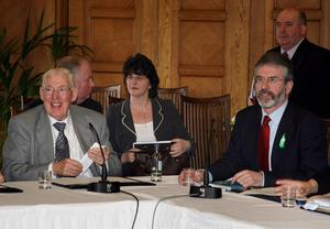 PACEMAKER BELFAST    26/3/2007 Democratic Unionist Party leader The Reverend Ian Paisley (left) and Sinn Fein President Gerry Adams speak to the media during a press conference at the Stormont Assembly building in Belfast after power-sharing restored.