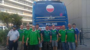 Philip Whyte (42), from South Belfast, and friends stand in front of the Poland team bus