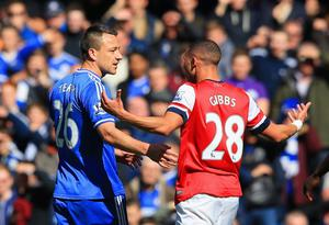 LONDON, ENGLAND - MARCH 22:  John Terry of Chelsea talks to Kieran Gibbs of Arsenal as he reacts after being shown a straight red during the Barclays Premier League match between Chelsea and Arsenal at Stamford Bridge on March 22, 2014 in London, England.  (Photo by Richard Heathcote/Getty Images)