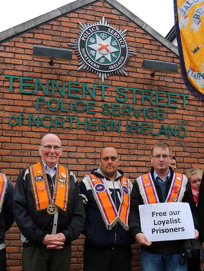 Loyalist protesters including Willie Frazer outside Tennent Street Police Station. Picture: Kevin Scott