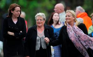 Kay Duddy (centre), sister of Bloody Sunday victim Jackie Duddy, attends the funeral of Dr Edward Daly at St Eugene's Cathedral in Londonderry. PRESS ASSOCIATION Photo. Picture date: Thursday August 11, 2016. The former Bishop of Derry who came to the aid of a dying civil rights protester on Bloody Sunday and waved a white handkerchief in an enduring image of the Troubles died on Monday aged 82. See PA story ULSTER Daly. Photo credit should read: Niall Carson/PA Wire