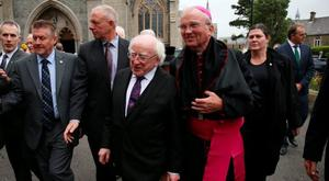 Irish President Micheal D Higgins is welcomed by Bishop Donal McKeown (front right) to the funeral of Dr Edward Daly at St Eugene's Cathedral in Londonderry. PRESS ASSOCIATION Photo. Picture date: Thursday August 11, 2016. The former Bishop of Derry who came to the aid of a dying civil rights protester on Bloody Sunday and waved a white handkerchief in an enduring image of the Troubles died on Monday aged 82. See PA story ULSTER Daly. Photo credit should read: Niall Carson/PA Wire