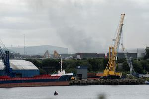 Smoke rises over Foyle Port at Strathfoyle outside Derry where a large fire is being tackled by the Fire Service. Picture Martin McKeown. 29.07.20