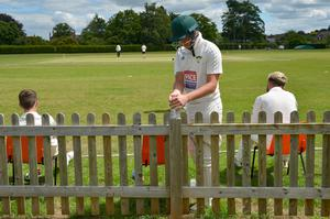 Players pause to use hand sanitiser during the match between Pershore CC and Stratford-upon-Avon CC at the The Bottoms, home of Pershore Cricket Club, Worcestershire. (Jacob King/PA)