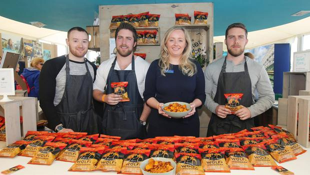 Press Eye - Belfast - Northern Ireland - 16th May 2018  First day of the 2018 Balmoral Show, in partnership with Ulster Bank, at Balmoral Park.  Wolf and Woodsman's David Knowles, Andy Laverty and Jonny Laverty with Lynsey Cunningham Regional Director, Entrepreneurship at Ulster Bank. Wolf and Woodsman was one of the companies provided with free space by Ulster Bank to exhibit in its marquee. The companies include Ulster Bank customers and entrepreneurs from the bank's Entrepreneur Accelerator.  Picture by Jonathan Porter/PressEye