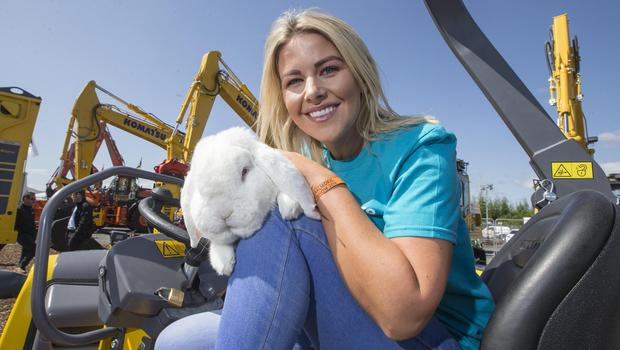 REPRO FREE McAuley Multimedia 16/05/18 Marcia McNally, TechXpert at Ulster Bank meets Zeldan the Giant French Lop during day one of the 2018 Balmoral Show in partnership with Ulster Bank. Pic Steven McAuley/McAuley Multimedia