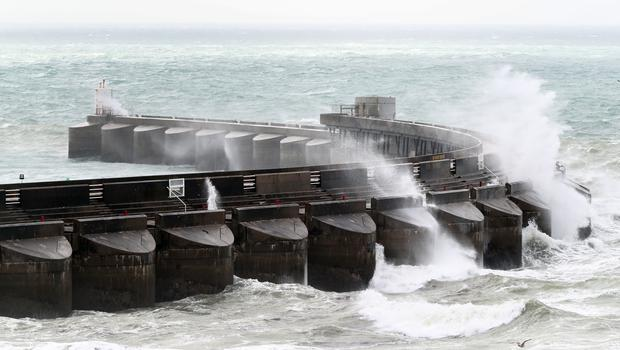 Waves crash over the marina wall in Brighton, East Sussex, as stormy weather arrives across the UK (Gareth Fuller/PA)