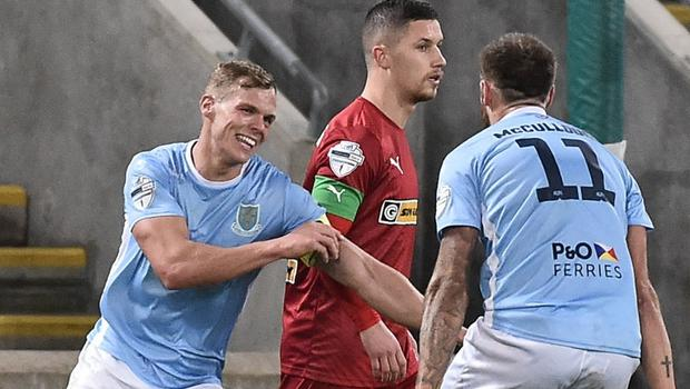 Ballymena skipper Leroy Millar (left) celebrates his goal.