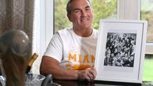 George with a photo of his Linfield squad.