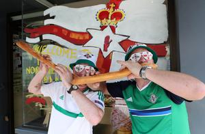 Northern Ireland fans Eddie McCullough and Ian Thompson pictured at the boulangerie in Georges de Reneins, France ahead of the opening Euro 2016 game against Poland in Lyon on Sunday. Press Eye - Belfast -  Northern Ireland - 09th June 2016 - Photo by William Cherry