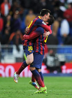 Lionel Messi (L) of Barcelona celebrates victory with Jordi Alba of Barcelona after the La Liga match between Real Madrid CF and FC Barcelona at the Bernabeu on March 23, 2014 in Madrid, Spain.  (Photo by Denis Doyle/Getty Images)