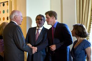 WASHINGTON, DC - MAY 09:  Prince Harry (Center R), along with British Ambassador to the US Sir Peter Westmacott (Center L), and his wife Lady Westmacott (R) greet Democratic Senator from Vermont Patrick Leahy (L)  before a reception in the Prince's honor at the Ambassador's residence on May 9, 2013 in Washington, DC. HRH Prince Harry will be undertaking engagements on behalf of charities with which the Prince is closely associated on behalf also of HM Government, with a central theme of supporting injured service personnel from the UK and US forces. (Photo by Jim Lo Scalzo-Pool/Getty Images)