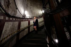 A visitor descending the steps of Down Street disused underground station in Mayfair, London, where Winston Churchill took refuge at the height of the Blitz, for the launch of a new season of Hidden London disused station tours. PRESS ASSOCIATION Photo. Picture date: Wednesday April 13, 2016. Down Street had a short life as a working station from 1907 to 1932, but became critical to winning the Second World War when it was covertly transformed into the Railway Executive Committee's bomb-proof bunker. Photo credit should read: Yui Mok/PA Wire