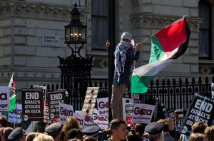 A pro-Palestinian demonstrator waves the Palestinian flag outside the gates of Downing Street in London on September 9, 2015, during a protest to oppose the visit of Israeli Prime Minister Benjamin Netanyahu. Over 100 pro-Israeli demonstrators and hundreds of pro-Palestinian activists rallied in front of Downing Street in London ahead of a planned visit of Israeli Prime Minister Benjamin Netanyahu. Netanyahu visits Britain this week for talks with his counterpart David Cameron as the right-wing Israeli leader faces diplomatic pressure over West Bank settlements and stalled peace efforts. AFP PHOTO / JUSTIN TALLISJUSTIN TALLIS/AFP/Getty Images