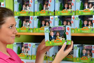 Early Learning Centre's Abi Hutchinson stocks shelves with its Happyland Royal baby sets.  Staff up and down the country have been busy stocking the 50,000 limited edition toy sets overnight.