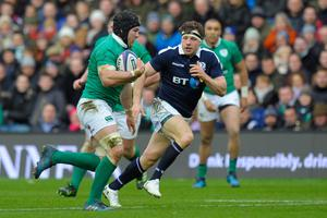 Ireland's flanker Sean O'Brien (L) runs during the Six Nations international rugby union match between Scotland and Ireland at Murrayfield in Edinburgh, Scotland on Febuary 4, 2017.   / AFP PHOTO / Andy BuchananANDY BUCHANAN/AFP/Getty Images