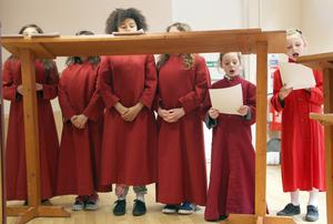 Around 100 children from Edenbrooke, Cliftonville Integrated and Sacred Heart primary schools have come together to form the choir. Pic: Colm O'Reilly/Sunday Life.