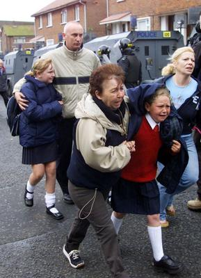 Terrified children on their way to Holy Cross Girls Primary School at the height of the dispute in 2001