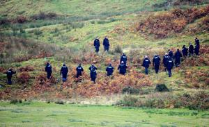 File photo dated 8/10/2012 of a police team search land near Machynlleth, Mid Wales for the missing five year old April Jones.  Former slaughterhouse worker Mark Bridger has been found guilty of abducting and murdering schoolgirl April Jones