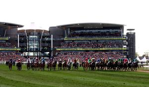 The runners and riders at the start of the Crabbie's Grand National Chase during Grand National Day of the Crabbie's Grand National Festival at Aintree Racecourse, Liverpool.  David Davies/PA Wire