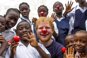A photo issued by Comic Relief of Ed Sheeran who visited the Street Child Liberia project in Liberia as part of a previous charity campaign (Comic Relief)