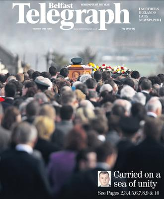 "Belfast Telegraph. Page One.  7/4/2011.  ""Carried on a sea of unity"" Ronan Kerr. Funeral. Murdered. PSNI officer."