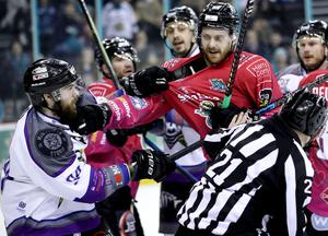 Belfast Giants forward Ciaran Long and Manchester Storm defenceman Declan Balmer square up to each other during Saturday night's game at the SSE Arena (William Cherry/Presseye)