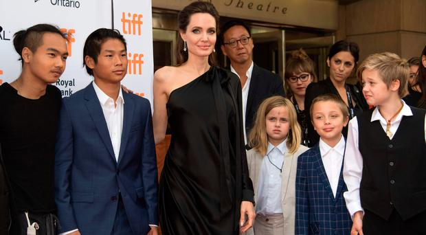 Angelina Jolie with her children at a premiere. From left, Maddox, Pax, Vivienne, Knox and Shiloh