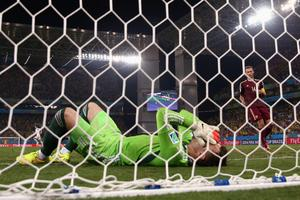 CUIABA, BRAZIL - JUNE 17:  Igor Akinfeev of Russia lies in the net after failing to save a shot by Lee Keun-Ho of South Korea (not pictured) for South Korea's first goal during the 2014 FIFA World Cup Brazil Group H match between Russia and South Korea at Arena Pantanal on June 17, 2014 in Cuiaba, Brazil.  (Photo by Warren Little/Getty Images)