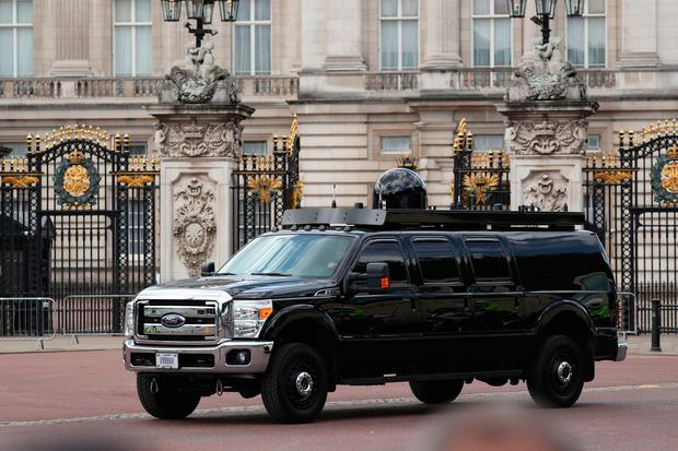 Part of the President's motorcade drives past Buckingham Palace, London, during the first day of a state visit to the UK by US President Donald Trump.