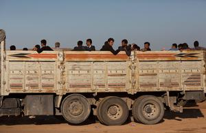 SANLIURFA, TURKEY - OCTOBER 01:  Refugees ride in the back of a truck after crossing the border from Syria into Turkey on October 1 , 2014 near Suruc, Turkey. Kurdish troops are engaged in a battle against fighters of the Islamic State (IS, also called ISIS and ISIL) to defend the strategic nearby Kurdish border town of Kobani (also called Ayn Al-Arab), which ISIS has surrounded on three sides. The Turkish Parliament is due to vote on a measure on October 2, which would allow Turkish ground forces to enter Syria, creating a buffer zone to protect fleeing refugees from the ISIS advance.  (Photo by Carsten Koall/Getty Images)
