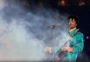 (FILES) This file photo taken on February 4, 2007 shows US musician Prince performing during half-time at Super Bowl XLI at Dolphin Stadium in Miami between the Chicago Bears and the Indianapolis Colts.    Pop icon Prince -- one of the most influential but elusive figures in music -- died suddenly at his compound in Minnesota on April 21, 2016, a representative said. He was 57. / AFP PHOTO / JEFF HAYNES AND Roberto SCHMIDTJEFF HAYNES,ROBERTO SCHMIDT/AFP/Getty Images