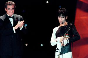 "This photo taken on May 4, 1994 shows musician Prince (R) acknowledging applause after receiving from Italian tenor Placido Domingo (L) the ""Outstanding Contribution to the Pop Industry"" award during the World Music Awards ceremony in Monaco.   Pop icon Prince -- whose pioneering brand of danceable funk made him one of music's most influential figures -- died on April 21, 2016 at his compound in Minnesota. He was 57. The announcement came just a week after the Grammy and Oscar winner was taken to hospital with a bad bout of influenza, although he made light of his health problems after the scare.   / AFP PHOTO / Patrick HERTZOGPATRICK HERTZOG/AFP/Getty Images"
