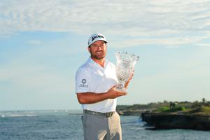 PUNTA CANA, DOMINICAN REPUBLIC - MARCH 31: Graeme McDowell of Northern Ireland poses with the trophy after putting in to win on the 18th green during the final round of the Corales Puntacana Resort & Club Championship on March 31, 2019 in Punta Cana, Dominican Republic. (Photo by Mike Ehrmann/Getty Images)
