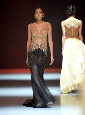 DUBAI, UNITED ARAB EMIRATES - OCTOBER 05:  A model walks the runway at the Dany Tabet show during Fashion Forward at Madinat Jumeirah on October 5, 2014 in Dubai, United Arab Emirates.  (Photo by Ian Gavan/Getty Images for Fashion Forward)