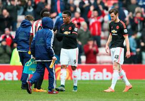 SUNDERLAND, ENGLAND - FEBRUARY 13: Dame N'Doye (2nd L) of Sunderland and Anthony Martial (2nd R) of Manchester United shake hands after the Barclays Premier League match between Sunderland and Manchester United at the Stadium of Light on February 13, 2016 in Sunderland, England.  (Photo by Clive Brunskill/Getty Images)