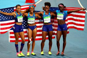 RIO DE JANEIRO, BRAZIL - AUGUST 19:  English Gardner, Allyson Felix, Tianna Bartoletta and Tori Bowie of the United States celebrate winning gold in the Women's 4 x 100m Relay Final on Day 14 of the Rio 2016 Olympic Games at the Olympic Stadium on August 19, 2016 in Rio de Janeiro, Brazil.  (Photo by Ian Walton/Getty Images)