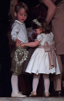 ENGLEFIELD GREEN, ENGLAND - MAY 20: Britain's prince George (L), a pageboy, attends the wedding of his aunt Pippa Middleton to James Matthews at St Mark's Church on May 20, 2017 in Englefield Green, England.  (Photo by Justin Tallis - WPA Pool)