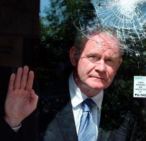 File photo dated 23/06/09 of Deputy First Minister Martin McGuinness looking at a smashed window at the City Church in the University area of Belfast. PA