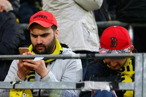 DORTMUND, GERMANY - APRIL 11:  Fans of Dortmund are concerned  of the bomb attack to the bus of Borussia Dortmund prior to the UEFA Champions League Quarter Final first leg match between Borussia Dortmund and AS Monaco at Signal Iduna Park on April 11, 2017 in Dortmund, Germany.  (Photo by Christof Koepsel/Bongarts/Getty Images)