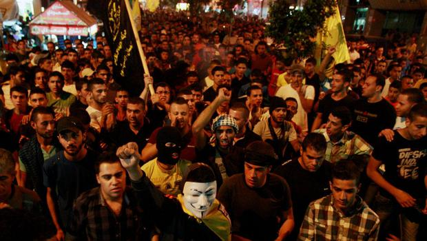 In this Friday, July 25, 2014 photo, Palestinians chant slogans to support the Palestinians in Gaza, while protesting in the West Bank city of Jenin. In the West Bank, which had been relatively calm for years, protests raged Friday against Israel's Gaza operation and the rising casualty toll there. (AP Photo/Mohammed Ballas)