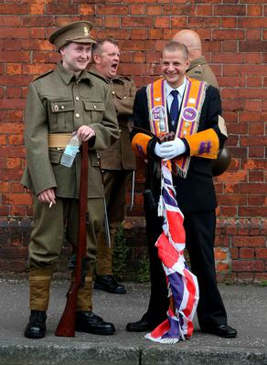 Orangemen, some in period costume wait for the start, as the main 12th July parade moves off from Carlisle circus in Belfast, on July 12, 2016. 12th July is the main marching day in the Orange Order calendar. The parades mark the 326th anniversary of King William III's victory at the Battle of the Boyne in 1690. / AFP PHOTO / PAUL FAITHPAUL FAITH/AFP/Getty Images