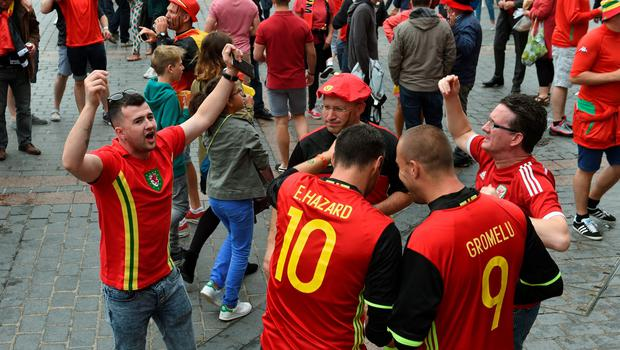 Wales and Belgium fans mingle in the centre of Lille before the UEFA Euro 2016, quarter final match at the Stade Pierre Mauroy, Lille. PRESS ASSOCIATION Photo. Picture date: Friday July 1 2016. See PA story SOCCER Wales. Photo credit should read: Joe Giddens/PA Wire. RESTRICTIONS: Use subject to restrictions. Editorial use only. Book and magazine sales permitted providing not solely devoted to any one team/player/match. No commercial use. Call +44 (0)1158 447447 for further information.