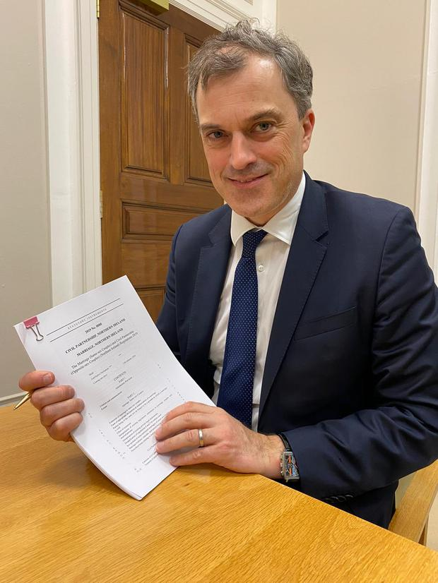 Secretary of State Julian Smith with the signed regulation.