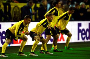 Dortmund's players warm up before the UEFA Europe League quarter-final, first-leg football match Borussia Dortmund vs Liverpool FC in Dortmund, western Germany on April 7, 2016. / AFP PHOTO / PATRIK STOLLARZPATRIK STOLLARZ/AFP/Getty Images