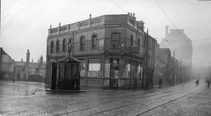 A block of derelict houses in Divis Street, Belfast, ready for demolishing.  28/12/1934