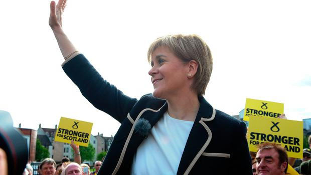 Scotland's First Minister and leader of the Scottish National Party Nicola Sturgeon waves as she holds a final general election campaign rally on June 7, 2017, in Edinburgh, Scotland. Britain on June 3 headed into the final day of campaigning for a general election darkened and dominated by jihadist attacks in two cities, leaving forecasters struggling to predict an outcome on polling day.   / AFP PHOTO / Andy BuchananANDY BUCHANAN/AFP/Getty Images
