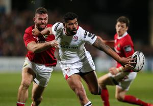 28 October 2016 - Picture by Darren Kidd / Press Eye.     Ulster v Munster at Kingspan Stadium, Belfast.  Ulster's Charles Piutau is tackled by Munster's Jaco Taute