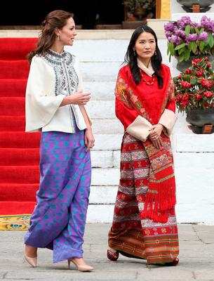 THIMPHU, BHUTAN - APRIL 14:  Catherine, Duchess of Cambridge walks with HM Jetsun Pema Wangchuck in front of monks in the Tashichhodzong (fortress) on the first day of a two day visit to Bhutan on the 14th April 2016 in Paro, Bhutan. The Royal couple are visiting Bhutan as part of a week long visit to India and Bhutan that has taken in cities such as Mumbai, Delhi, Kaziranga, Bhutan and Agra.  (Photo by Chris Jackson/Getty Images)