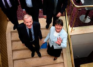 DUP leader and Northern Ireland former First Minister Arlene Foster (R) waves to the media alongside Gregory Campbell (L) after holding a press conference with the DUP's newly elected Westminster candidates who stood in the general election on June 9, 2017 in Belfast, Northern Ireland.  (Photo by Charles McQuillan/Getty Images)